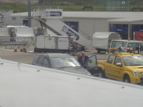 The King was the first one off the plane where a car was waiting for him. I took this picture from inside the plane, it's the closest I've ever been to a king!